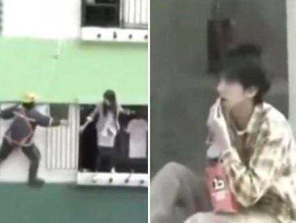 女性が飛び降り自殺をしようとしている横でポップコーンを食べている男