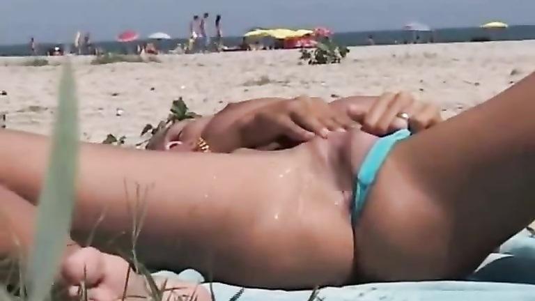 Girl masturbating on beach